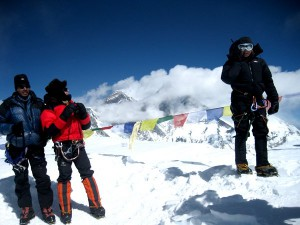 Climber happy to be at the top of Ama Dablam, sharing news back home by sattelite phone.